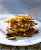 Stacked Fried Corn Fritters with Honey