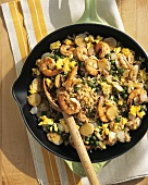 Seafood Paella in a Skillet with Wooden Spoon