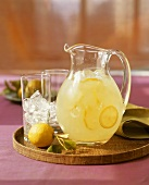 Pitcher of Lemonade with Glass with Ice