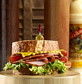 Ham, Mustard and Lettuce Sandwich with Olive Toothpick
