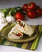Turkey Wrap; Halved on a Plate