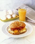 Breakfast Sandwich; Egg on Croissant with Orange Juice