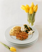 Salmon Cake with Pasta and Mixed Vegetables on Stacked Plates