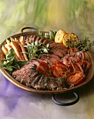 Sliced Herbed Beef on Platter with Roast Vegetables