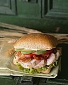 Sliced Pork Sandwich with Bacon and Avocado