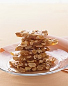 Stacked Peanut Brittle on a Glass Plate