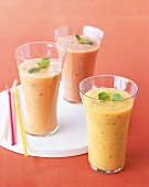 Fruit Smoothies with Mint Garnish; Straws