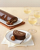 Slice of Chocolate Roulade; Glasses of White Wine