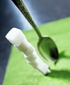 Tall Stack of Sugar Cubes; Spoon