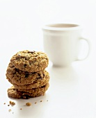 Stack of Oatmeal Raisin Cookies; Cup of Hot Chocolate