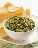 Bowl of Green Pea Salsa with Chips