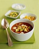 Bowl of Tortilla Soup with Avocado; Spoon; Tortilla Chips