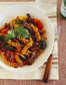 Grilled Steak and Tomato Pasta on a White Plate
