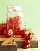 Homemade Tomato Puree in a Glass Jar; Fresh Tomatoes