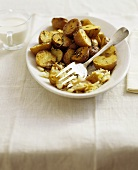 Herb Roasted Potatoes in Serving Dish; Serving Fork