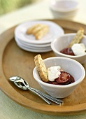 Bowls of Stewed Plums with Cream and Biscotti