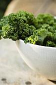 Fresh Kale in a Ceramic Bowl