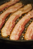 Bacon Cooking in a Skillet