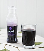 Acai Juice in Glass; Bottle of Acai Juice