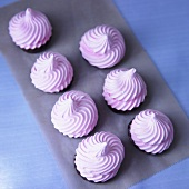 Pink Meringues Dipped in Dark Chocolate; From Above