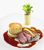 Duck breast with apple charlotte with parsnip puree and radish sprouts