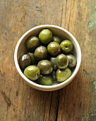 Bowl of Gourmet Olives on a Rustic Wooden Table