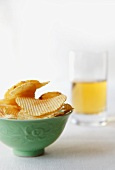 Bowl of Ridged Potato Chips and Glass of Beer