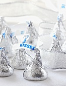 Group of Chocolate Kisses and Silver Ribbon