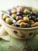 Bowl of Mixed Olives with a Fork
