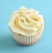 Coconut Cupcake with Butter Cream Frosting and Toasted Coconut
