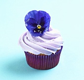 Violet Frosted Cupcake with Primrose Garnish
