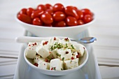 Bowl of Marinated Feta Cheese; Bowl of Tomatoes