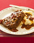 Swiss Steak with Mashed Potatoes; Tomato Sauce Covered Steak