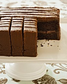 Wellesley Fudge Cake; Chocolate Layer Cake on Pedestal Dish; Slice Removed