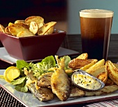 Fish and Chips; Whole Battered Fish with Potatoes and Salad; Guinness Beer