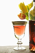 Glass of Light Organic Rose Wine; Tulips
