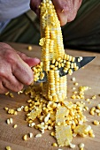 Man Cutting Corn Kernels from the Cob