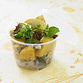 Golden Beet Salad with Walnuts and Greens in a Plastic Container
