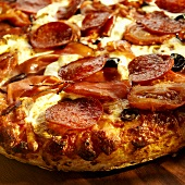 Pizza with Pepperoni, Speck and Olives