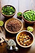 Tofu, Quinoa, Cilantro and Pea Pods in Wooden Bowls