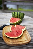 Slices of Watermelon on a Cutting Board on an Outdoor Table