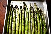 Seasoned Roasted Asparagus on a Baking Sheet