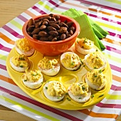 Platter of Deviled Eggs with a Bowl of Smoked Almonds