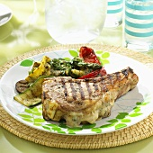 Grilled lamb chop stuffed with Gruyere cheese with grilled vegetables