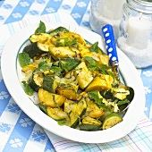 A plate of grilled courgette and summer squash with mint