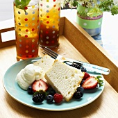 Two Slices of Angel Food Cake with Berries and Whipped Cream; Iced Tea