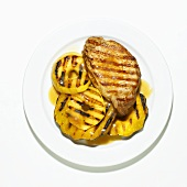 Grilled Boneless Pork Chop with Grilled Pineapple Slices; White Background