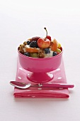Bowl of Fruit Salad with Yogurt and Granola with Cherry on Top
