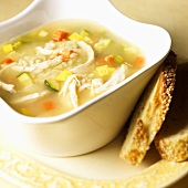 Bowl of Chicken and Rice Soup; Slices of Bread