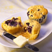Blueberry Corn Muffins; One Halved on Plate; Knife and Butter